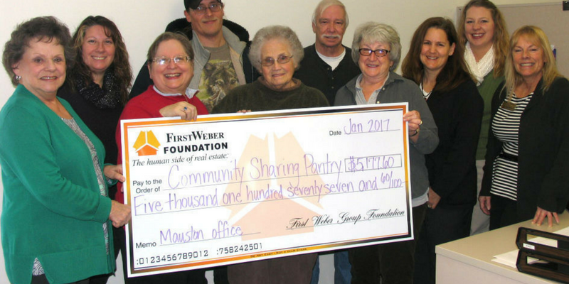 First Weber Foundation & Mauston office donate over $10,000 to local food pantry & American Cancer Society