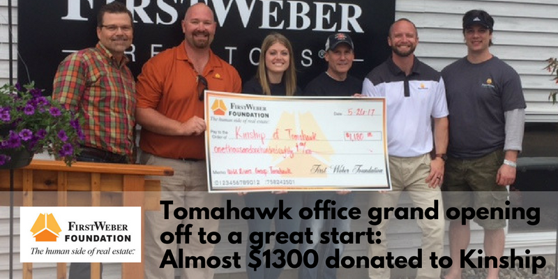 Tomahawk office grand opening off to a great start: Check presented to local non-profit Kinship